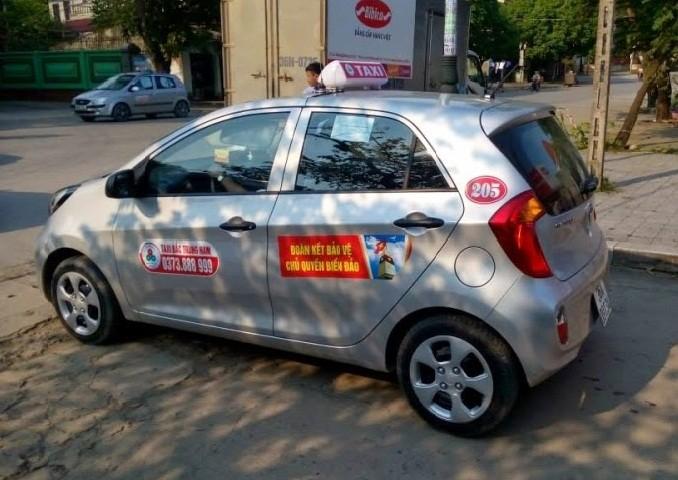 quảng cáo trên xe taxi Bắc Trung Nam